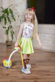 Happy pretty little blond girl cleaning house Royalty Free Stock Photography