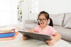 Happy pretty little girl finished school homework Stock Photography