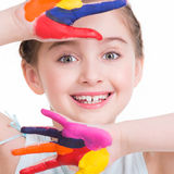 Happy pretty little girl with painted hands. Royalty Free Stock Images