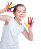 Happy pretty little girl with painted hands. Stock Images
