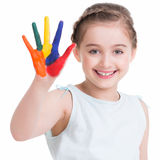 Happy pretty little girl with painted hands. Royalty Free Stock Photo