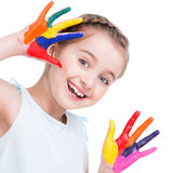 Happy pretty little girl with painted hands. Happy pretty little girl with painted hands - isolated on white stock images