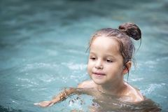 Pretty little girl in swimming pool Stock Images