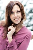 Happy and pretty middle aged woman outside in the snow stock photography
