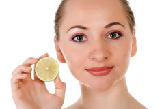 Happy pretty model posing with half of lime Royalty Free Stock Photography