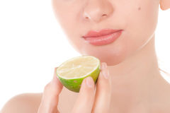 Happy pretty model posing with half of lime Stock Photo