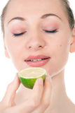 Happy pretty model posing with half of lime Stock Photography