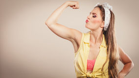 Happy pretty pin up girl showing off muscles. Stock Images