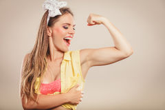 Happy pretty pin up girl showing off muscles. Royalty Free Stock Images