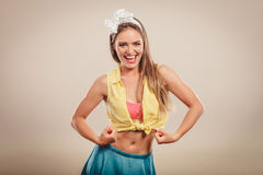 Happy pretty pin up girl showing off muscles. Royalty Free Stock Image