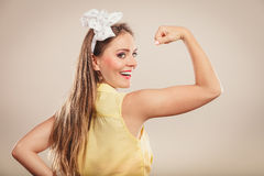 Happy pretty pin up girl showing off muscles. Stock Photos
