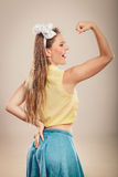 Happy pretty pin up girl showing off muscles. Royalty Free Stock Photos