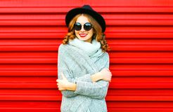Happy pretty portrait smiling woman wearing a knitted clothes Stock Photos