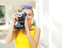Happy pretty smiling young woman with retro vintage camera Royalty Free Stock Image