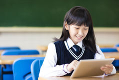 Happy pretty  student girl with tablet  in classroom Stock Image