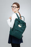 Happy pretty teenage girl in glasses with backpack looking back Royalty Free Stock Photography