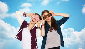 Happy pretty teenage girls with donuts having fun Royalty Free Stock Photography