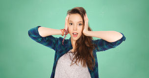 Happy pretty teenage student girl holding to head Stock Images