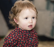 Happy & Pretty Toddler with Brown Eyes & Flowered Dress Stock Images
