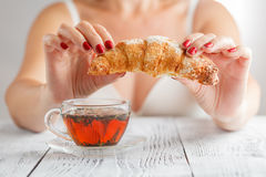 Happy pretty wife and her morning breakfast Royalty Free Stock Photography