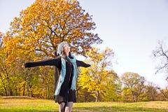 Happy pretty woman at the autumn park. royalty free stock photos