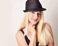 Happy Pretty Woman with Black Hat on White Royalty Free Stock Photography