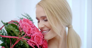 Happy Pretty Woman with a Bouquet of Pink Roses stock footage
