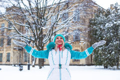 Happy pretty woman enjoy snow in winter park Royalty Free Stock Image