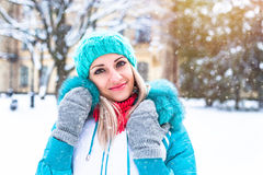 Happy pretty woman enjoy snow in winter park Royalty Free Stock Photos
