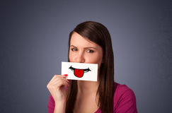 Happy pretty woman holding card with funny smiley Royalty Free Stock Photo