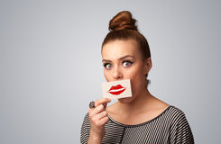 Happy pretty woman holding card with kiss lipstick mark Royalty Free Stock Photography