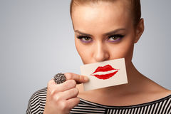 Happy pretty woman holding card with kiss lipstick mark Stock Photography