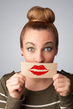 Happy pretty woman holding card with kiss lipstick mark Royalty Free Stock Image
