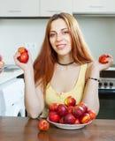 Happy pretty  woman holding nectarines Royalty Free Stock Photos