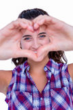 Happy pretty woman making heart shape with hands Stock Images