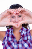 Happy pretty woman making heart shape with hands Royalty Free Stock Image