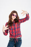 Happy pretty woman in pink sunglasses standing and showing gestures Stock Photos