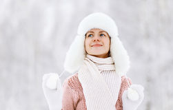 Happy pretty woman in sweater and hat enjoying the winter Stock Photo