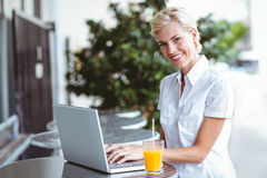 Happy pretty woman using her laptop computer Royalty Free Stock Photo