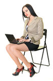Happy pretty woman using laptop Stock Image