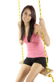 Happy pretty young girl swinging on a swing Royalty Free Stock Photos