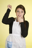 Happy pretty young girl wearing cooking apron Stock Photography