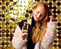 Happy pretty young Laughing Women hold and Drinking Champagne on royalty free stock photo
