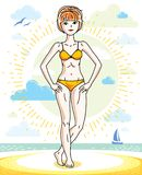 Happy pretty young red-haired woman standing on tropical beach a Royalty Free Stock Image