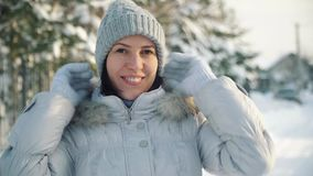 Happy young woman posing for the camera in the suburbs in winter. stock video