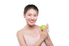 Happy pretty young woman show apple benefit to health, asian bea. Uty Royalty Free Stock Images