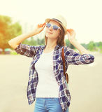 Happy pretty young woman wearing a sunglasses and hat Stock Photography