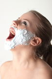 Happy pretty young woman with white beard Royalty Free Stock Image