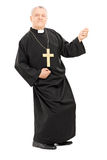 Happy priest playing air guitar Royalty Free Stock Photo