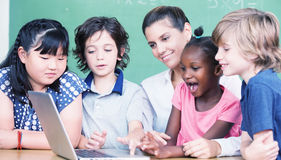 Happy primary class concept. Students learning computer science Royalty Free Stock Photography